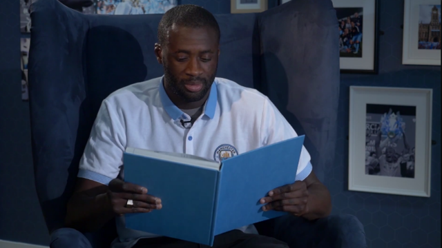 BUZZIN: Yaya Toure takes a lesson in Mancunian