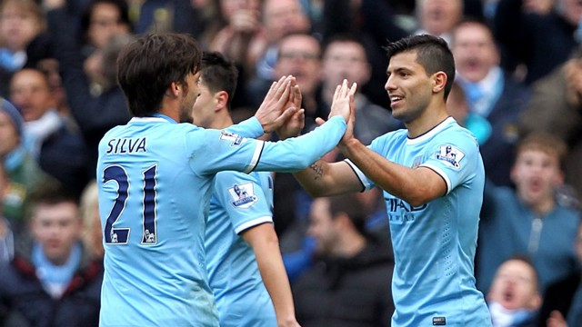 CELEBRATE: Silva and Aguero come together during the match between Manchester City and Arsenal in the 2013/14 season.