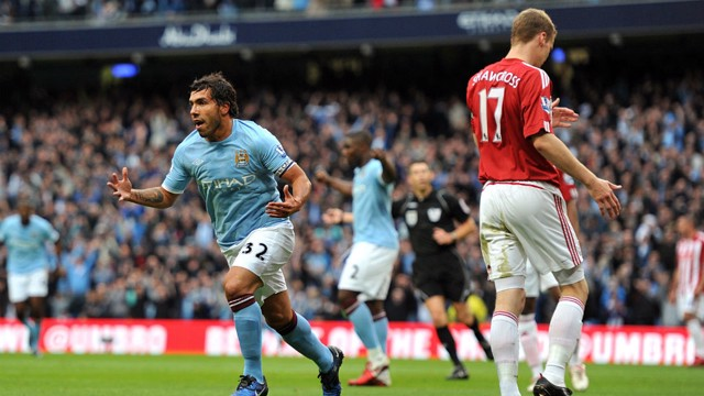 TEVEZ: Manchester City's striker celebrates scoring against Stoke in a 2011 victory