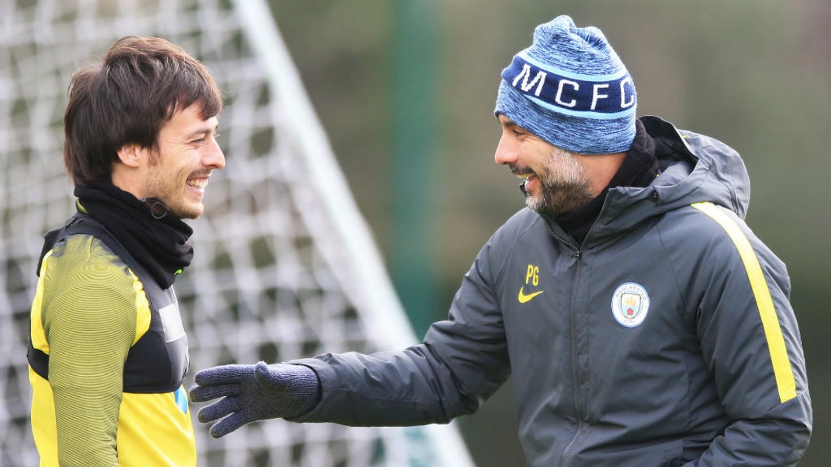 SPANIARDS: David Silva and Pep Guardiola share a moment during training