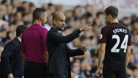 LEARNING: John Stones receives some instructions from the boss.