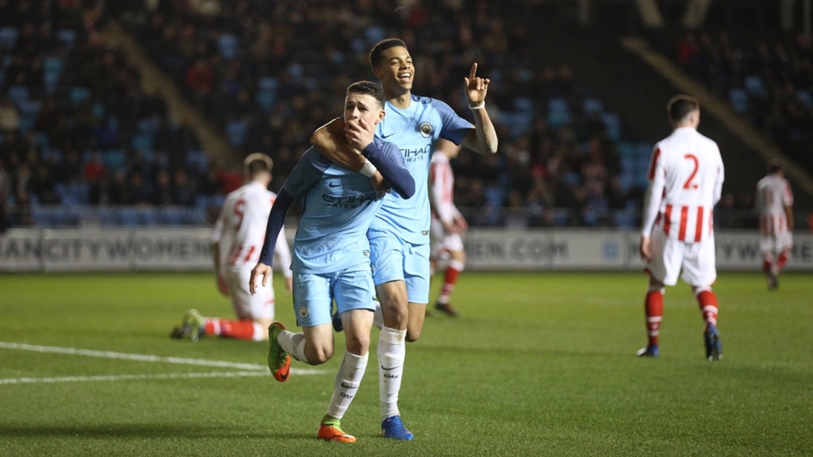 DOUBLE ACT: Lukas Nmecha and Phil Foden celebrate the latter's stunning solo effort