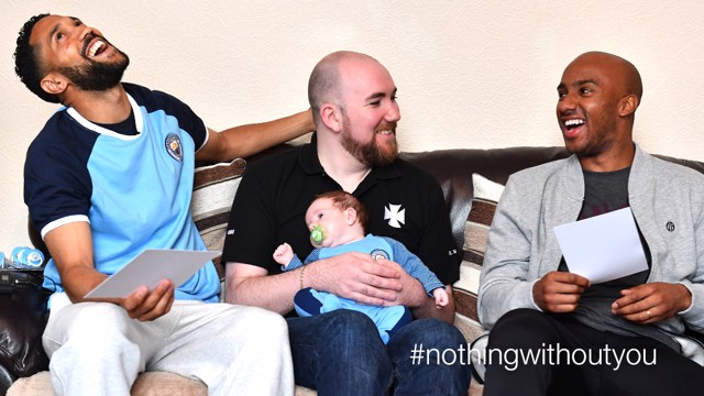 BABY BLUE: Gael Clichy and Fabian Delph met one of City's youngest fans