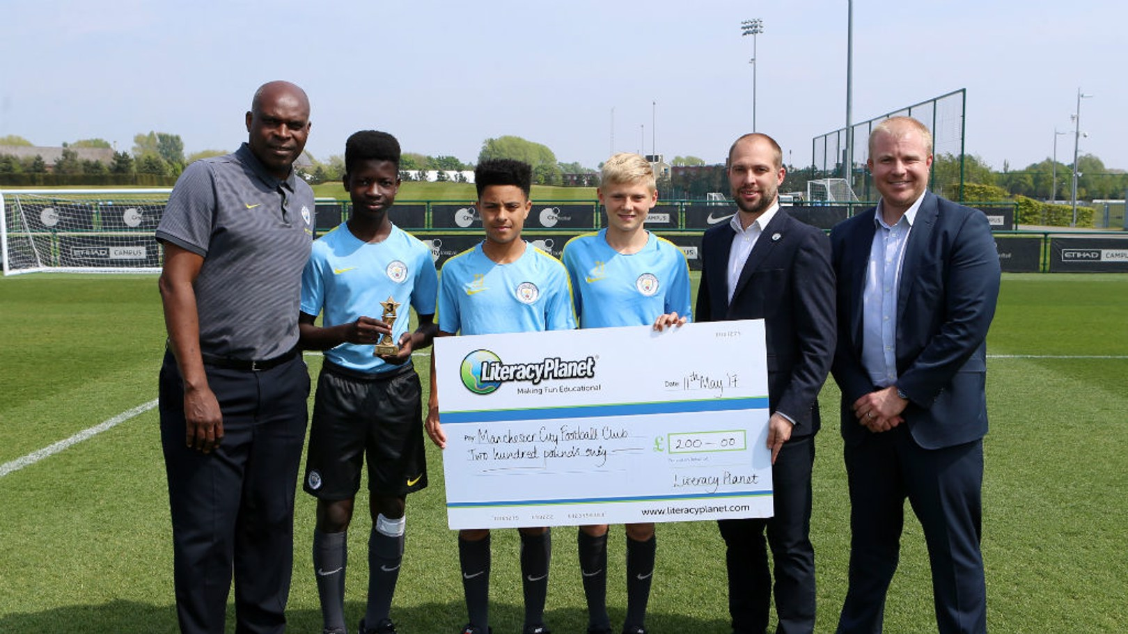 DONATION: Manchester City Academy collect their Word Mania literacy prize, which they have given to City in the Community.