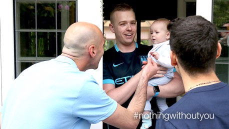 BABY BLUE: Willy Caballero and Jesus Navas meet one of Man City's youngest fans
