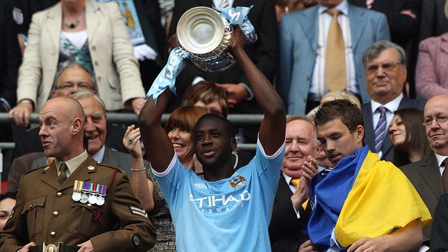 FIRST TROPHY: Yaya gets his hands on the FA Cup final after notching the winner at Wembley.