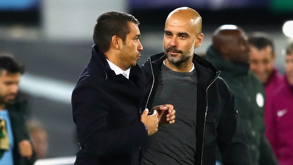 TOP COACHES: Giovanni Van Bronckhorst and Pep Guardiola share a lot of mutual respect