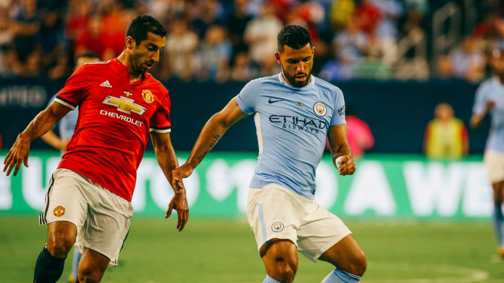 Sergio Aguero (right) in action during the Houston Manchester derby