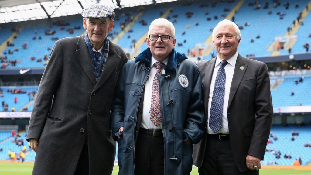MOTTY: Ahead of John Motson's final commentary appearance at the Etihad, Bernard Halford and Mike Summerbee presented him with a City sheepskin coat!