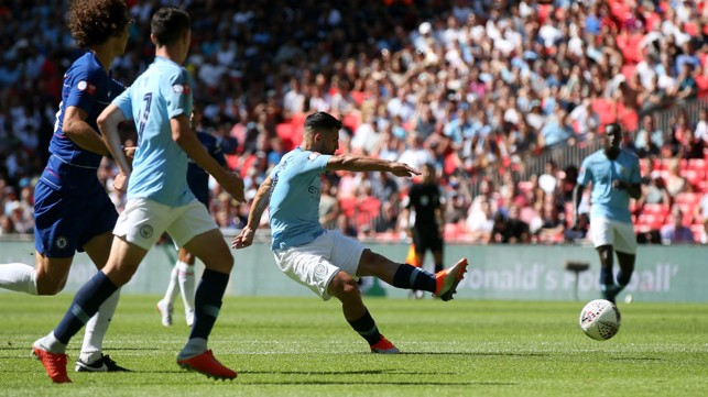 200 UP: Sergio Aguero shoots home against Chelsea at Wembley