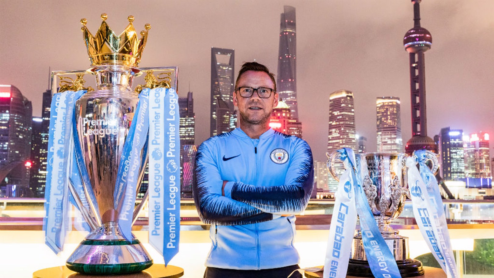 WORLD TOUR: Paul Dickov with City's silverware in Shanghai
