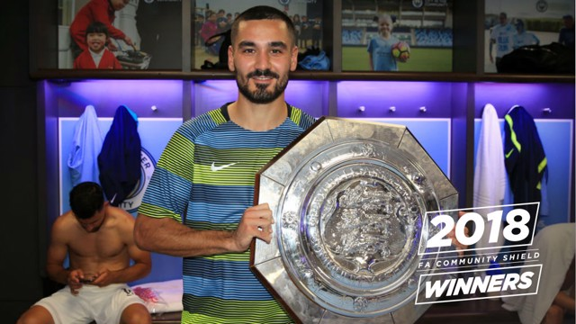SILVER SALVO: Ilkay Gundogan proudly displays the Community Shield following Sunday's 2-0 win over Chelsea