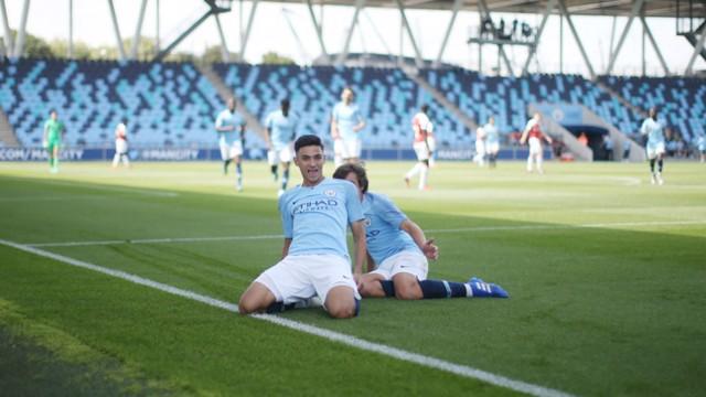 SHARP SHOOTER: Nabil Touaizi celebrates scoring against Arsenal