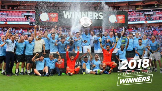 WHAT A FEELING: City lift the trophy