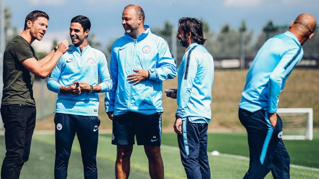 ALL SMILES: There was plenty of good humour when Xabi Alonso paid a visit to the CFA to watch training and reunited with Pep Guardiola and his coaching staff