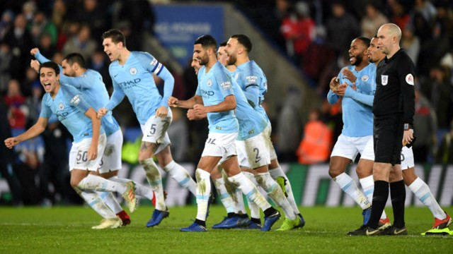 DELIGHT: Eric Garcia (far left) and the City players celebrate victory at the King Power Stadium