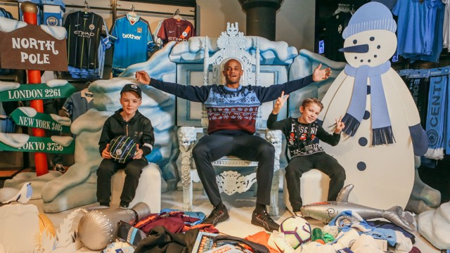 SANTA'S GROTTO: Vincent Kompany surprised two worthy young Blues and gave them some festive cheer