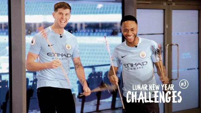 ON TARGET: Raheem Sterling and John Stones take on our Lunar New Year arrows challenge.