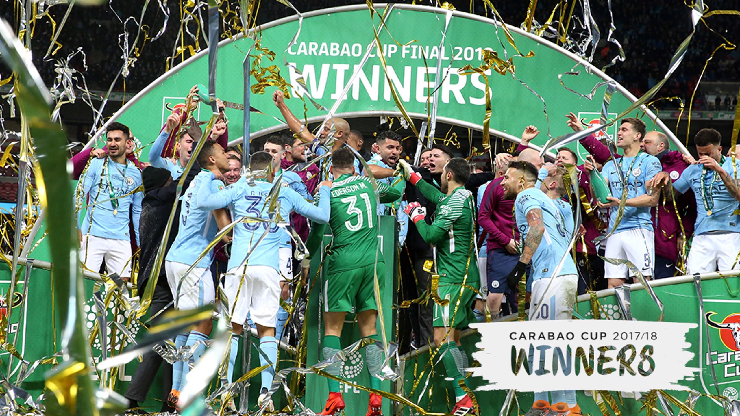 WINNERS: City lift the trophy