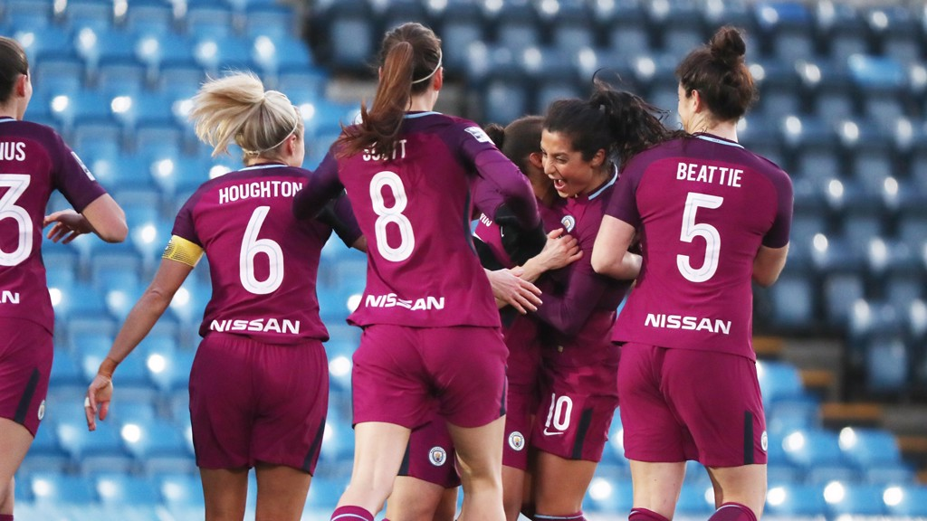 DEBUT: Nadia Nadim  celebrates with her new team mates after scoring City's first goal on her debut.