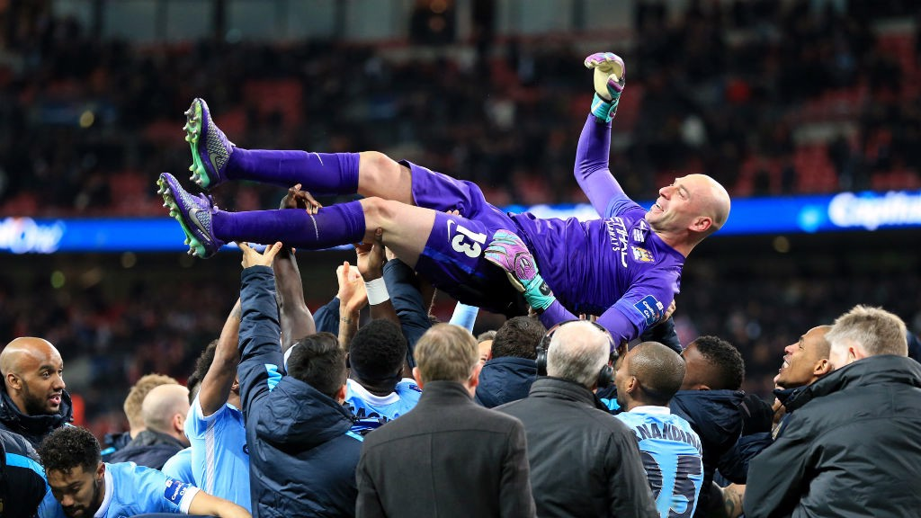 WEMBLEY HERO: City players herald Willy Caballero after the 2016 League Cup win.
