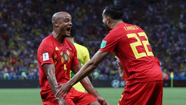 COMETH THE CAPTAIN: Vincent Kompany's header deflected in off City teammate Fernandinho to open the scoring against Brazil