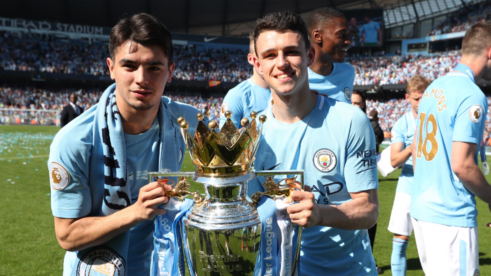 YOUNG STARS: Brahim Diaz and Phil Foden celebrate their first Premier League medals...