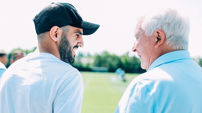 TWO GREATS MEET: Riyad is introduced to Club Ambassador Mike Summerbee