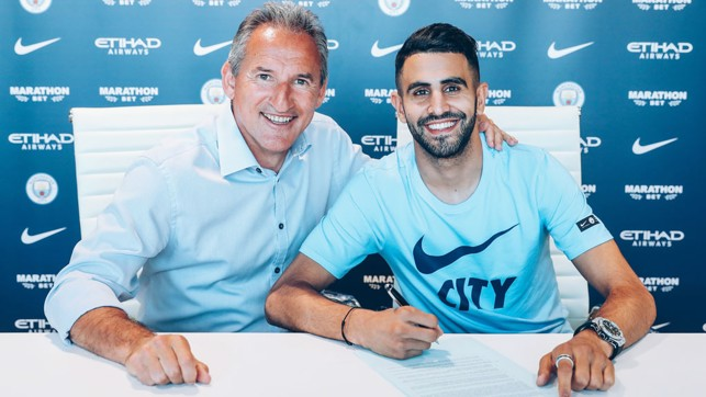 NEW RECRUIT: Riyad Mahrez poses for a snap with Txiki Begiristain