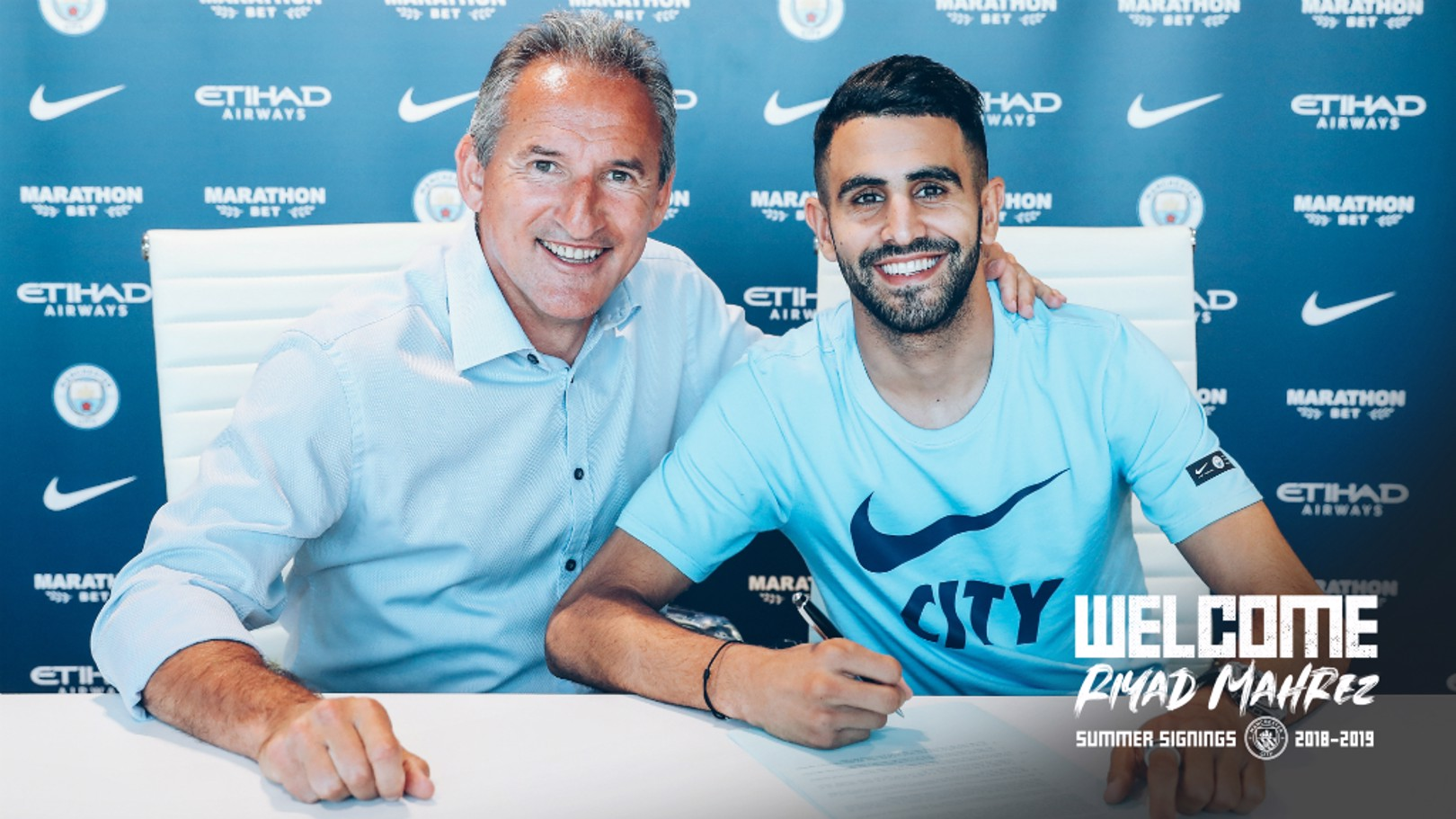 NEW BLUE: Riyad Mahrez puts pen to paper