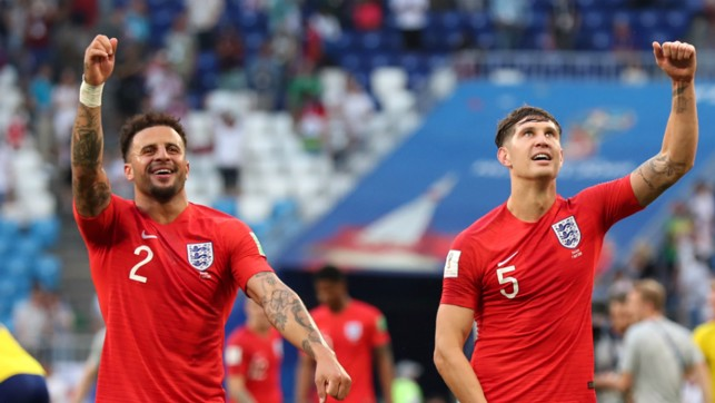 TWO LIONS: Kyle Walker and John Stones celebrate with the travelling England fans...