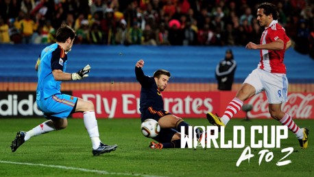 ACTION MAN: Roque Santa Cruz in the thick of the action for Paraguay against Spain at the 2010 World Cup finals