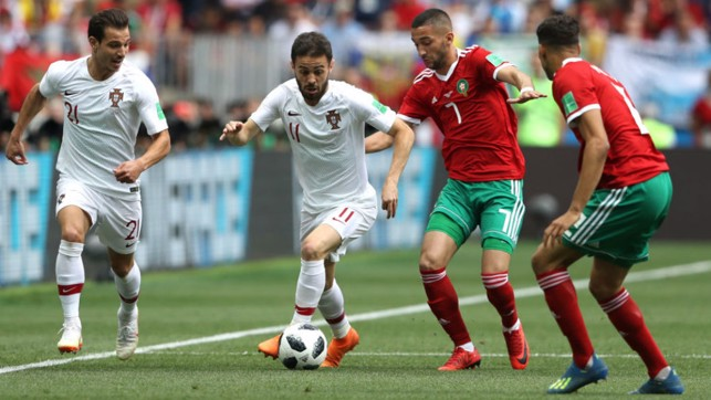 ON THE FRONT FOOT: Bernardo Silva in the thick of the action for Portugal against Morocco in Wednesday's Group B World Cup clash