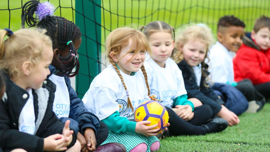 ALL SMILES: Young children enjoy a City in the Community Soccer School session