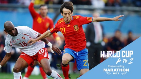 SOLID SILVA: David Silva in the thick of the action during Spain's triumphant 2010 World Cup campaign