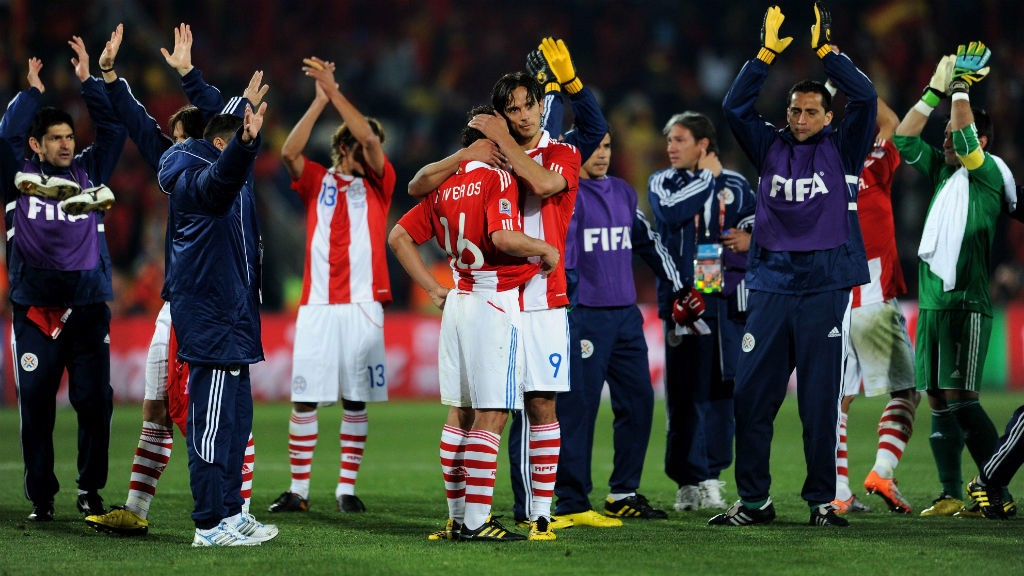 END OF THE WORLD: Roque Santa Cruz consoles his team-mates after Paraguay's 2010 World Cup elimination
