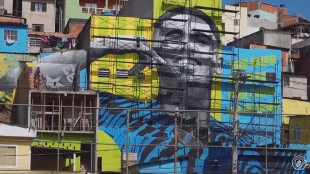 INSPIRATION: Gabriel Jesus adorns a mural in Sao Paulo, Brazil
