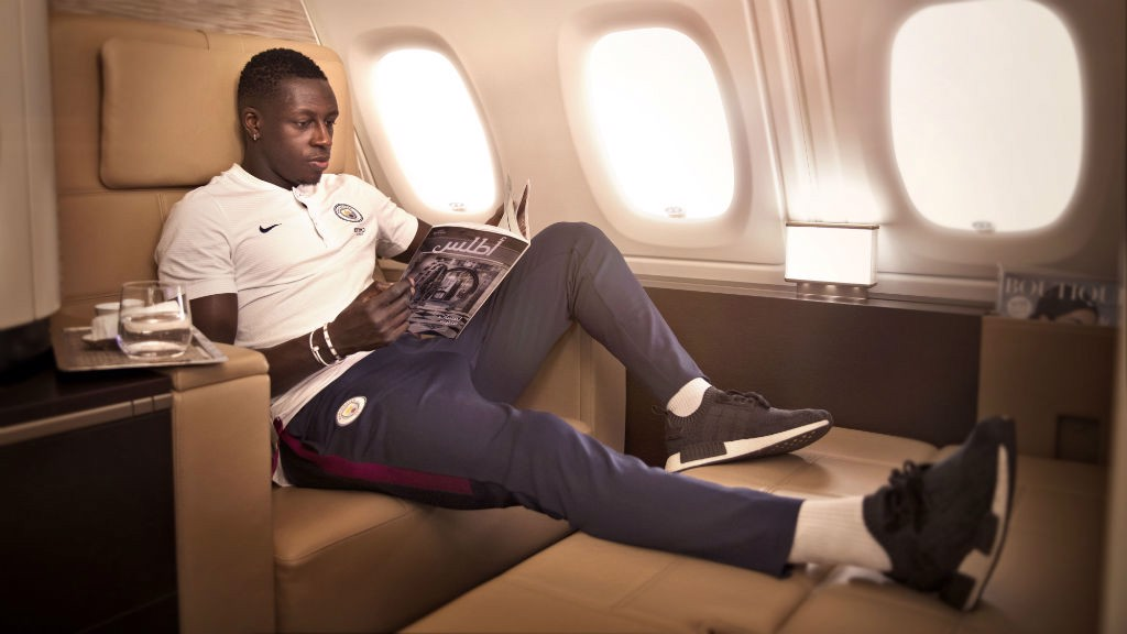HIGH FLYER: Manchester City defender Benjamin Mendy looks to relax during a long-haul flight