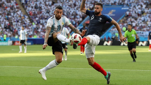BATTLE: Nicolas Otamendi challenges Olivier Giroud in the Argentina v France last 16 game