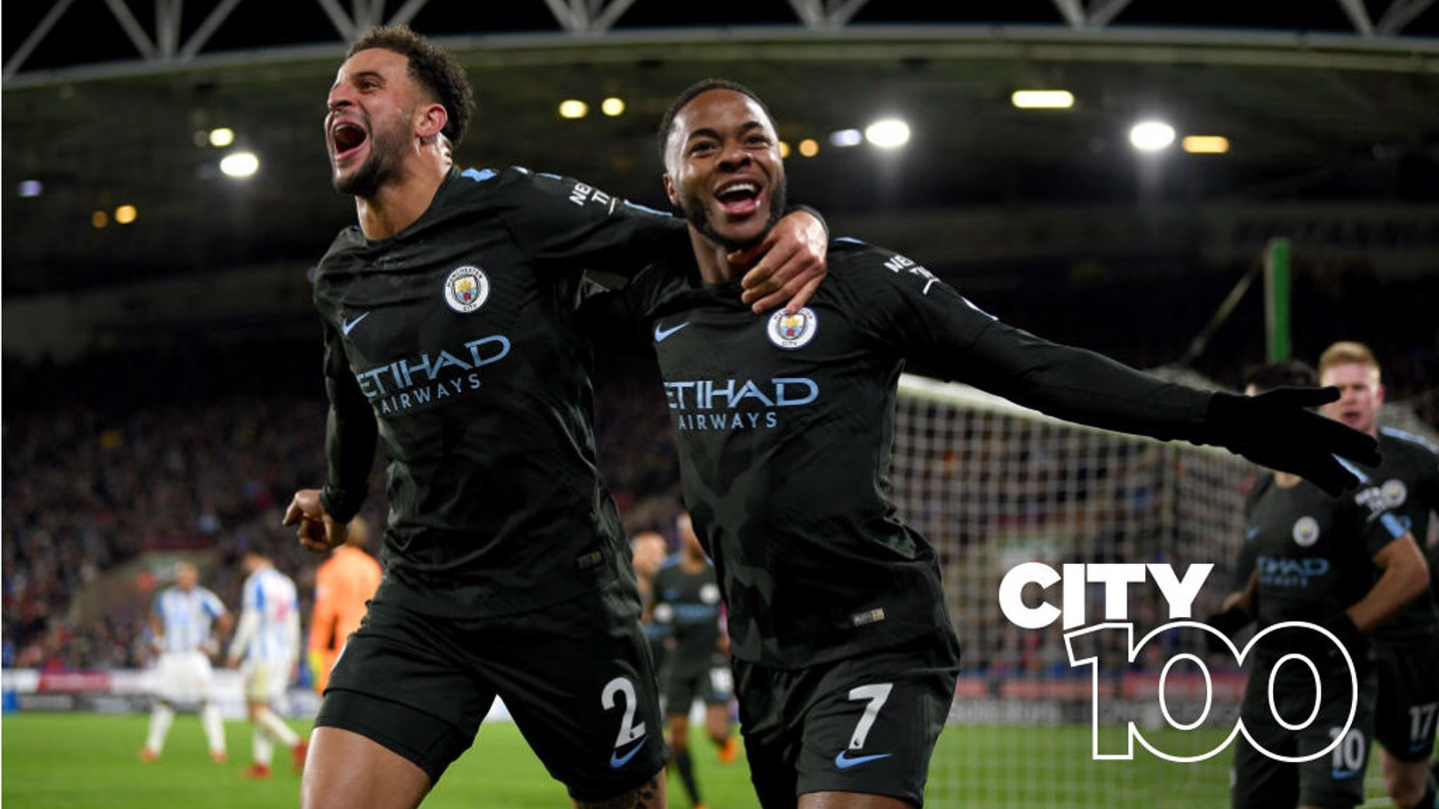 LATE, LATE SHOW: Raheem Sterling celebrates his dramatic late winner at Hudersfield with Kyle Walker