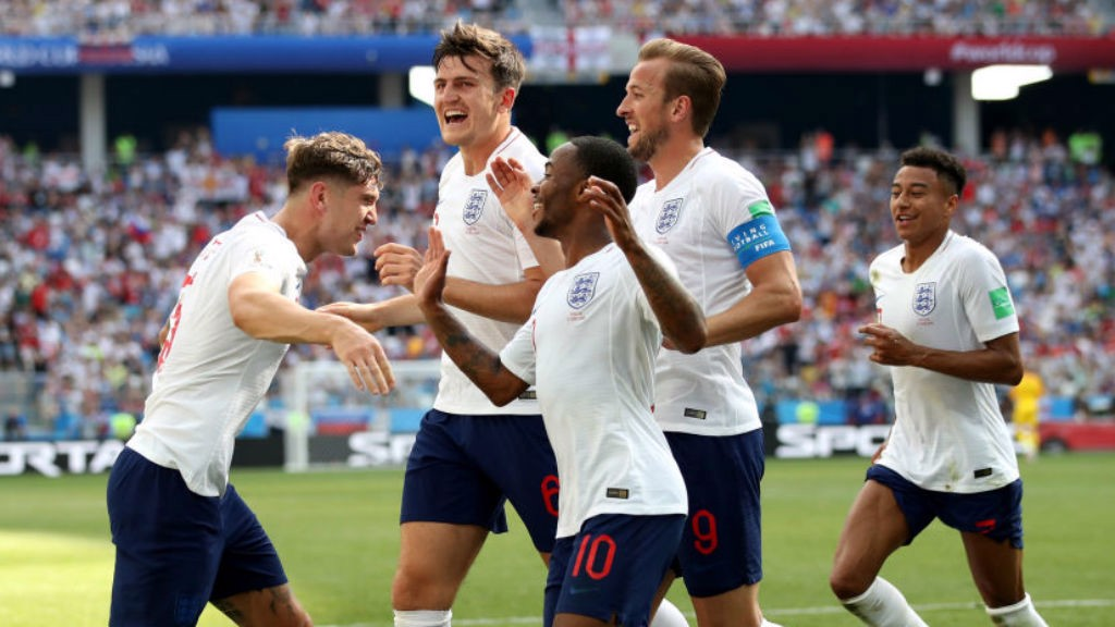 PRIDE OF LIONS: John Stones celebrates with England and City colleague after his second goal