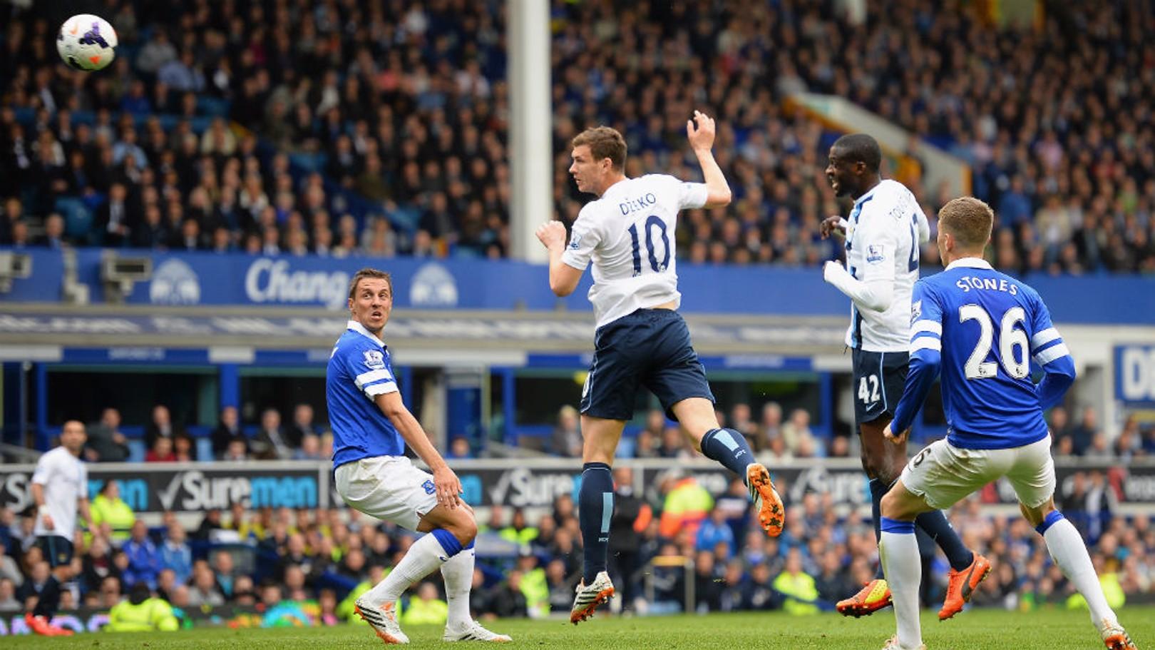 MATCH-WINNER: Edin Dzeko nets a crucial strike against Everton in the 2014 title run-in.