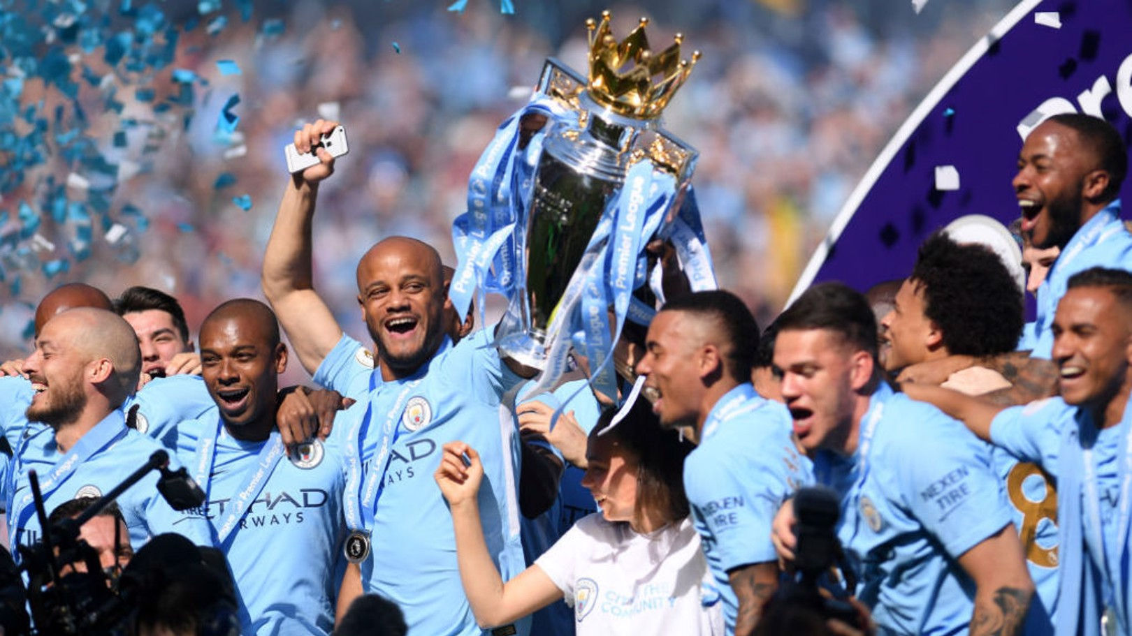CHAMPIONS: Kompany has praised the impact of Guardiola