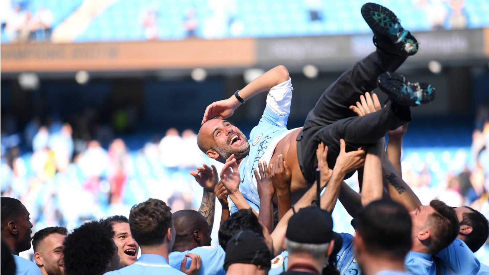 BUMPS FOR THE BOSS: The squad celebrate with Pep Guardiola