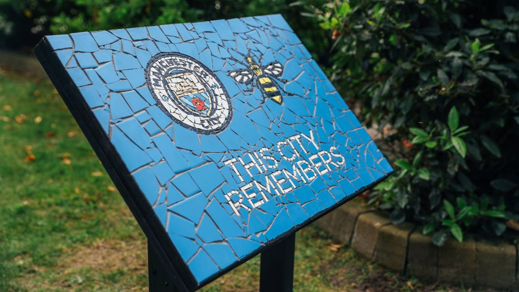 WE REMEMBER: A permanent mosaic in the Club's memorial garden