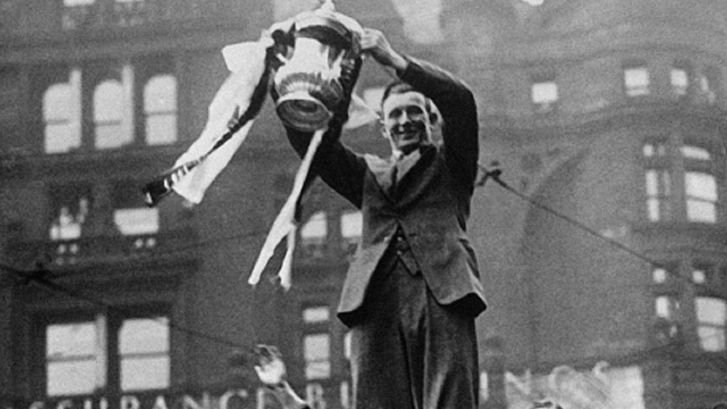 SAM COWAN: With the FA Cup on  top of a bus in the Manchester city centre
