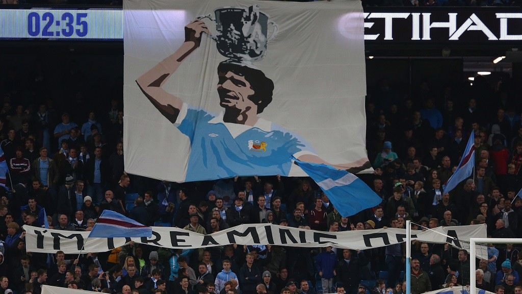 REMEMBERED: Mike Doyle flag at the Etihad
