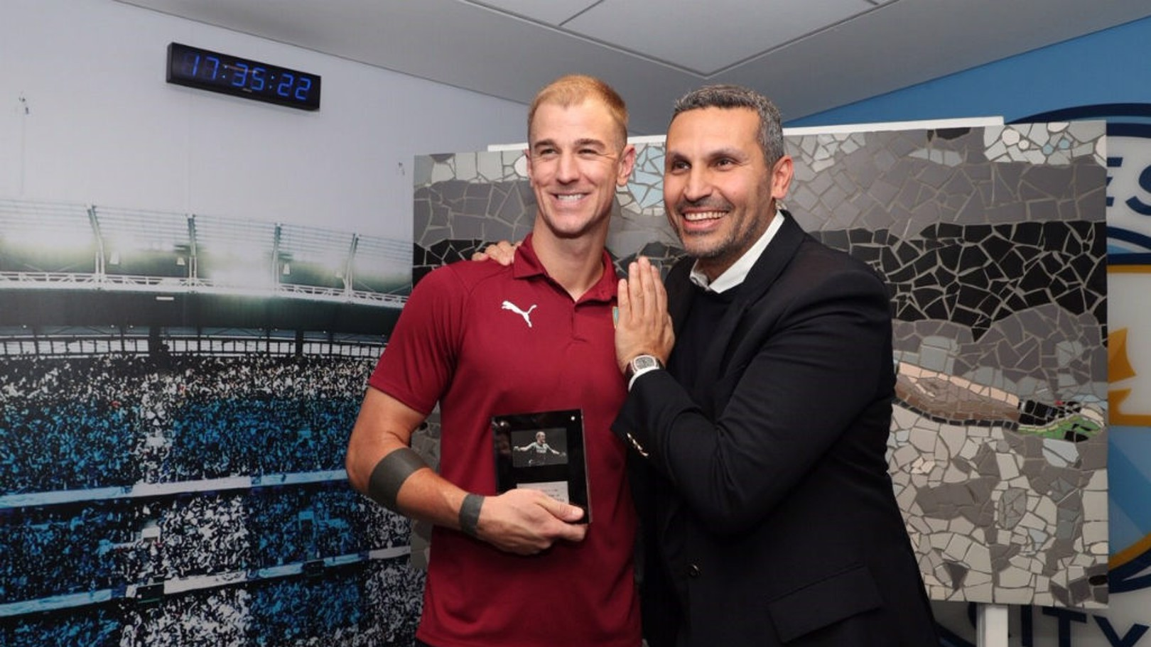SPECIAL TRIBUTE: Manchester City chairman Khaldoon Al Mubarak presents Joe Hart with a lifetime seasoncard and special replica mosaic