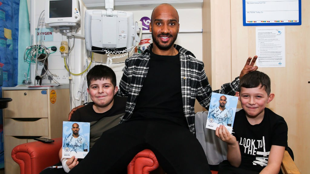TWO'S COMPANY: Fabian's surprise visit to the hospital went down a treat with these happy young patients