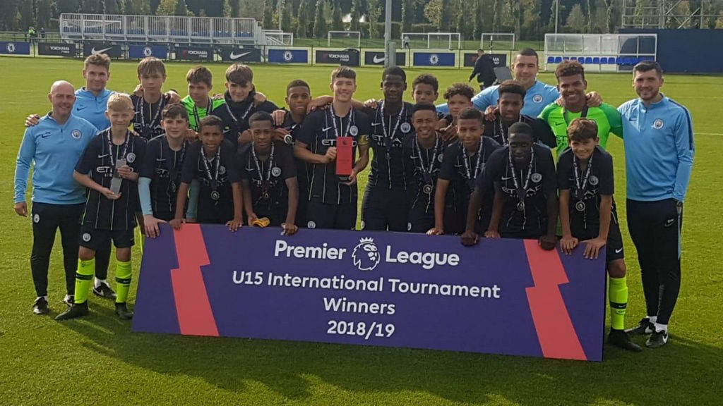 ALL SMILES: The victorious Manchester City Under-15s squad celebrate their achievement